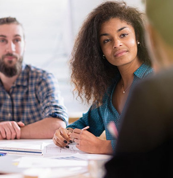 listening attentively in a meeting